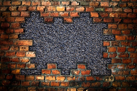 hole in an old brick wall - background Standard-Bild