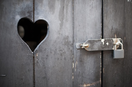padlocked: old door with a heart padlocked