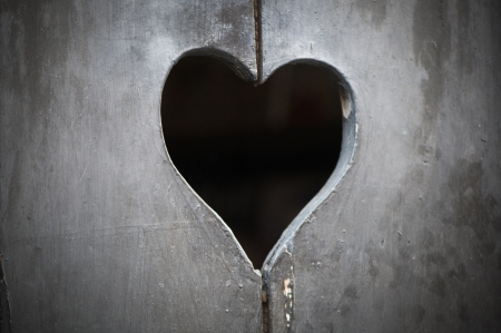 Wooden door with heart - vignette photo