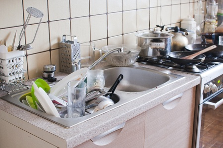 mess: dishes in the sink - mess in the kitchen Stock Photo