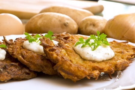 potato pancake with sour cream and parsley