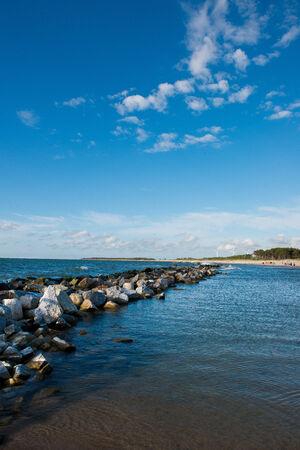 groyne: landscape - long breakwater, placed along the coast Stock Photo