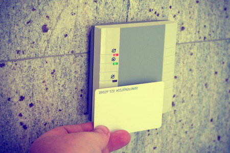 Man puts the card into the reader access photo