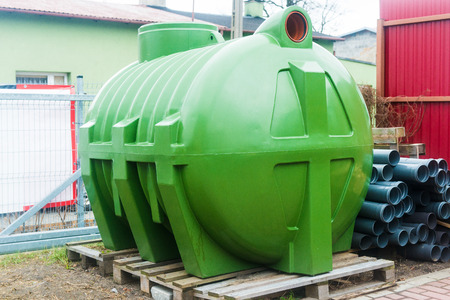 huge, green, plastic septic tank Stock Photo