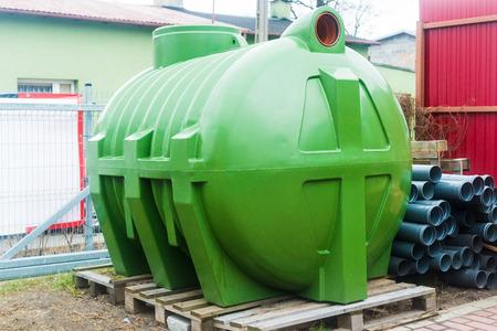 huge, green, plastic septic tank Standard-Bild