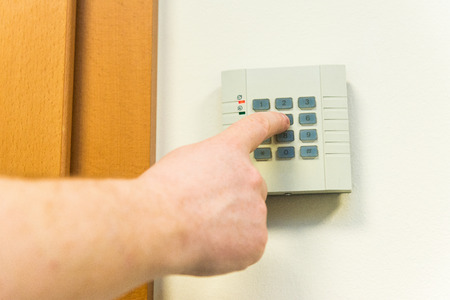 Man introduces code on access panel