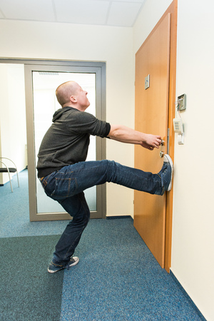 hindrance: white man opens the door force Stock Photo