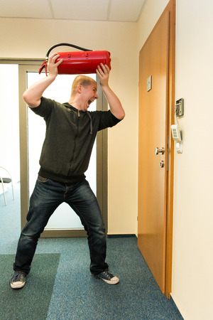opens: white man opens the door force Stock Photo