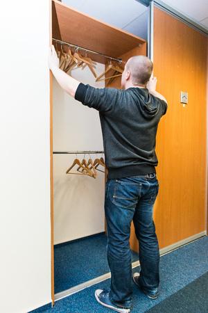 white Man looks into empty wardrobe photo