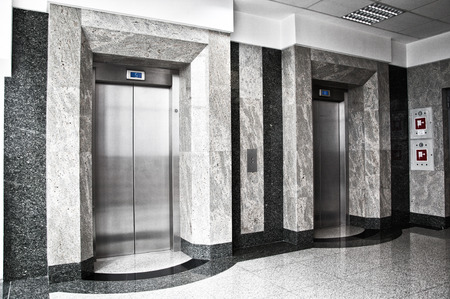 elevators: Two elevators in the office building Stock Photo
