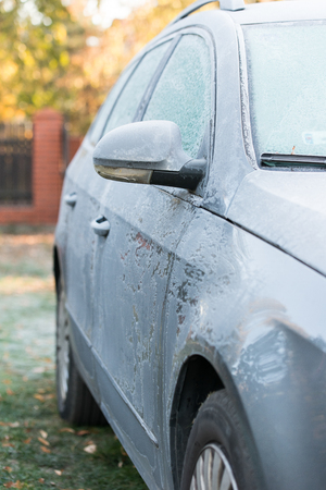 immobile: car covered with frost. Cold morning
