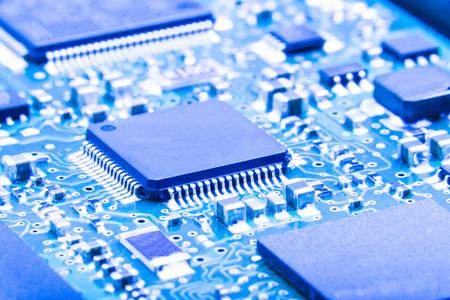 pcb: Electronic circuit board close up. Green PCB