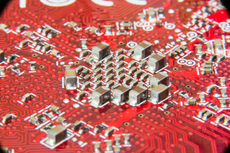 pcb: Electronic circuit board close up. Red PCB Stock Photo