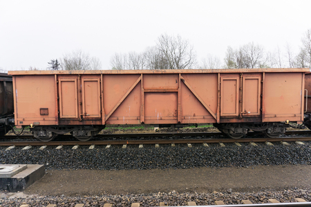 boxcar train: boxcar - wagon standing on the railway embankment Stock Photo