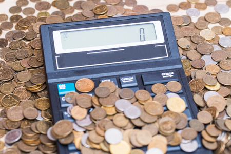 zloty: calculator and a stack of coins - Polish currency zloty Stock Photo