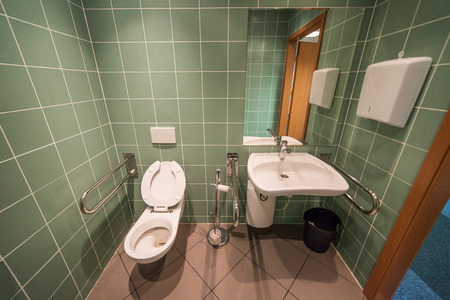 adapted: green, modern bathroom for the disabled