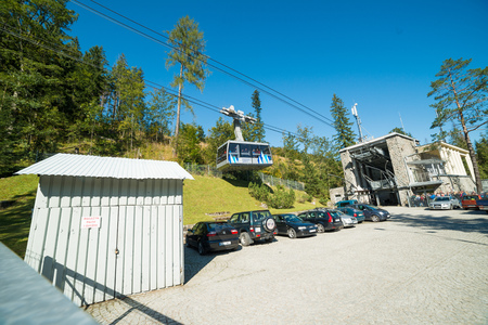 KUZNICE, POLAND-SEPTEMBER 18: Cable car carries passengers from Kuznice to Kasprowy Wierch peak on Septomer 18, 2017 in Zakopane, Poland. This cable car built in 1936, was the first of its kind in Poland Editorial
