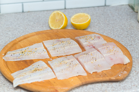 Fillet of fresh raw fish with spices on a kitchen board Stok Fotoğraf