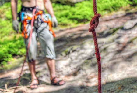 belay: The man is ready to belay a climber
