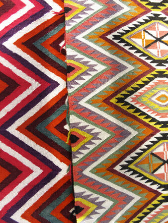 divided: Colourful rug background divided into two sections Stock Photo