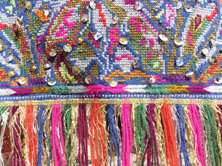 Colourful fringes - part of beautiful handmade craft Stock Photo