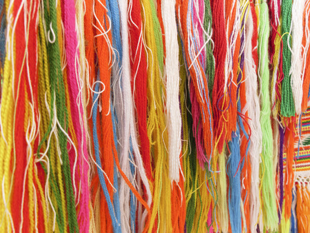fringes: Colourful fringes - part of beautiful handmade craft Stock Photo