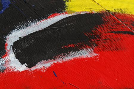 metal wall: Small part of painted metal wall with  blackred yellow and white paint   Colourful abstract backgroundClose up 6 Stock Photo