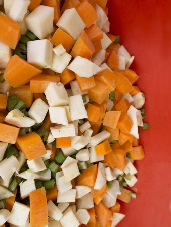 parsnips: Pile of mixed  healthy root vegetables, celery, parsnips, carrot and  celery stalk chopped for preparing a homemade soup 2