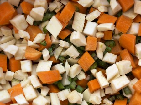 parsnips: Pile of mixed healthy root vegetables, celery, parsnips, carrot and  celery stalk chopped for preparing a homemade soup 3