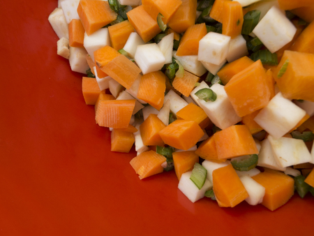 parsnips: Pile of mixed healthy root vegetables, celery, parsnips, carrot and  celery stalk chopped for preparing a homemade soup 8 Stock Photo