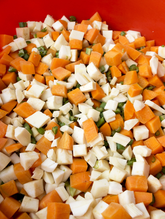 parsnips: Pile of mixed healthy root vegetables, celery, parsnips, carrot and  celery stalk chopped for preparing a homemade soup