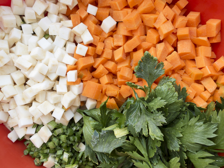 parsnips: Pile of mixed healthy root vegetables, celery, parsnips, carrot and  celery stalk chopped for preparing a homemade soup 12