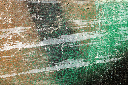 gruff: Small part of plastered hoarse,scratched and peeled surface area with green and brown paint -Abstract background-Close up