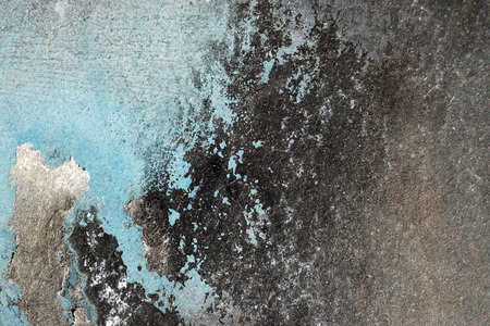 Small part of plastered hoarse,scratched and peeled surface area with blue and black paint -Abstract background-Close up