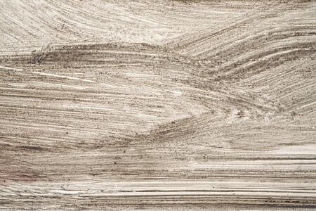 metal monochrome: Stroke of a brush with  brown  paint  on a metal fence -  Monochrome abstract background-Close up