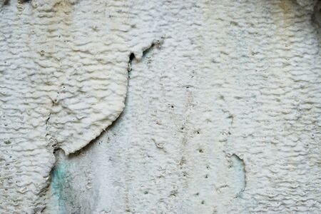 desalination: Limescale, a whitish chalky deposit on the wall caused by minerals leached from the water-Abstract background-Closeup Stock Photo