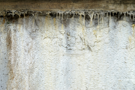 calc: Limescale, a whitish chalky deposit on the wall caused by minerals leached from the water-Abstract background-Closeup Stock Photo