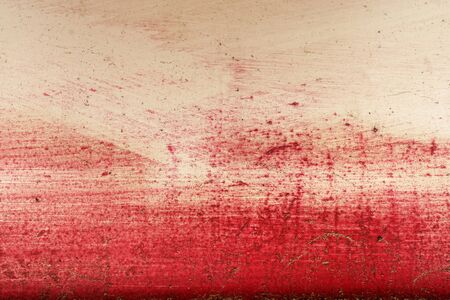 metal monochrome: Stroke of a brush with  red  paint  on a metal fence - Monochrome abstract background-Close up Stock Photo