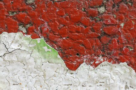 crumbling: Close up of dirty,crumbling,red concrete wall   Old,grungy,rough surface with gravel structure  and layer of cracked and peeled white and green paint Abstract texture background space for copy or text Stock Photo