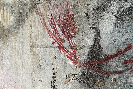 Cracked and peeled red, grey, black paint on old damaged wall. Small part of plastered, grungy, vintage, aged facade.Colorful abstract textured background - Close up Reklamní fotografie