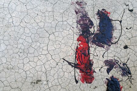 Plastered hoarse, cracked concrete wall with black and red paint stains - Abstract texture background-Close up