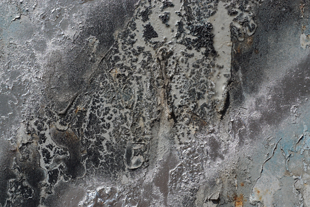Abstract textured background. Grunge metal close up.Rusty, dirty old metal sprinkled with black, grey and silver paint.Colorful, scratched, cracked and peeled layers. Macro.  스톡 콘텐츠