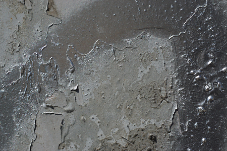 Abstract textured background. Grunge metal close up.Rusty, dirty old metal sprinkled with grey and silver paint.Colorful, scratched, cracked and peeled layers. Macro.  스톡 콘텐츠