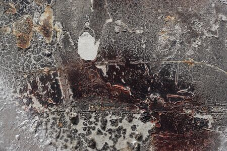 Abstract textured background. Grunge metal close up. Rusty, dirty old metal sprinkled with brown, grey and silver paint. Colorful, scratched, cracked and peeled layers. Macro. Imagens