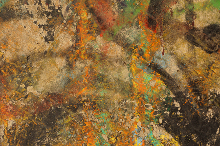 Multicolored abstract textured background.   Grungy aged plastered wall. Green, red, ocher, orange and brown paint - Close up