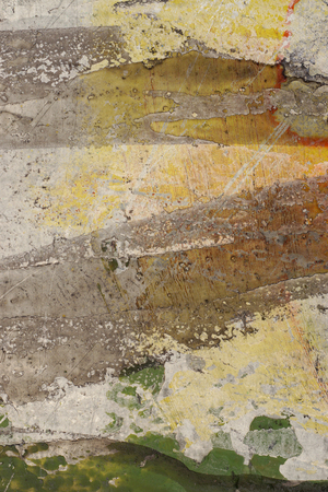 Brown, yellow, beige, green paint on grunge wall. Multicolored, abstract, textures, background. Close up of rough, weathered surface.
