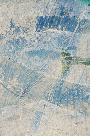 Blue, white paint on grunge wall. Abstract, textures, background. Close up of peeled, weathered surface.