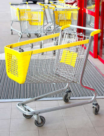 Shopping carts near supermarket outdoors