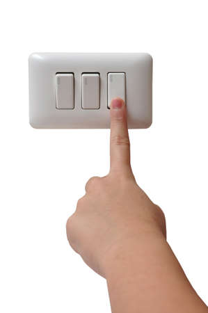 switch: Young Woman Turning Off Light Switch