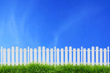 white picket fence: white fence and blue sky